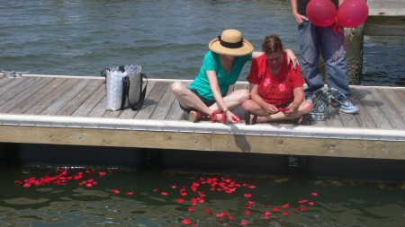Throwing rose petals on the water, in memory of our mother, June 2011.