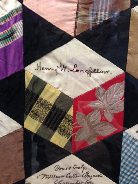 Closeup of a signature quilt with 360 prominent names.